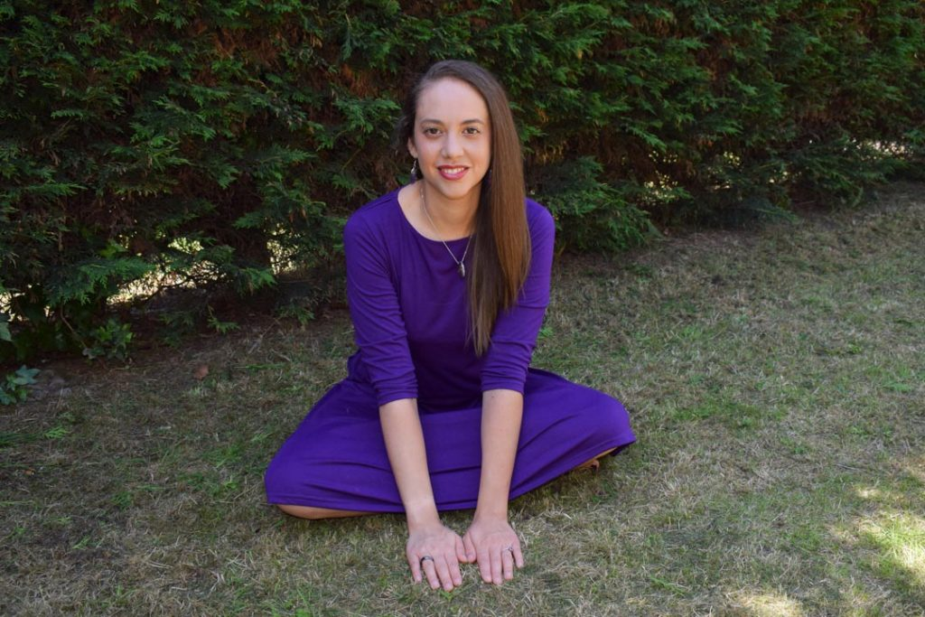 A Reiki practitioner grounds herself as she practises success consciousness